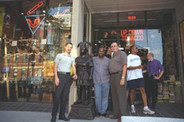 A group of our customers strike a pose with the most famous Cigar Store Indian in Chicago.