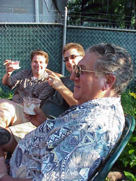 Three members of the Sciabica clan enjoy a drink and a cigar.