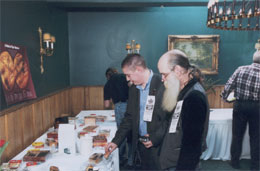 Carl Hurley and John Causgrove review the prize table.