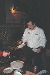 Paul Hendrickson slaves over a hot grill to make his delicious Jerk Chicken wings.